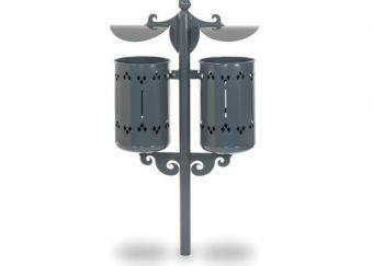 Cestino Pigalle Double, con paletto di sostegno decorato e tettucci in acciaio sagomato. Colore Grigio, conforme per il fissaggio al pavimento.