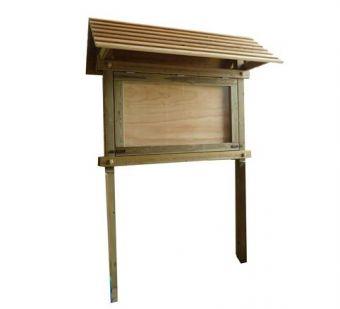 Bacheca a Ribalta, con anta ribaltabile in legno di pino nordico e policarbonato trasparente.